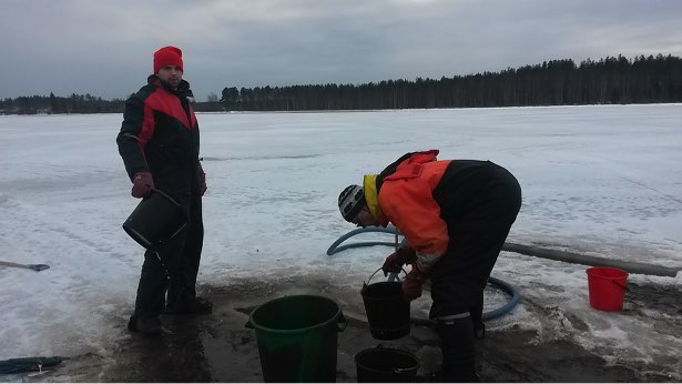 Taking chironomid core samples from a frozen lake with mining-derived pollution (photo by K. Väänänen